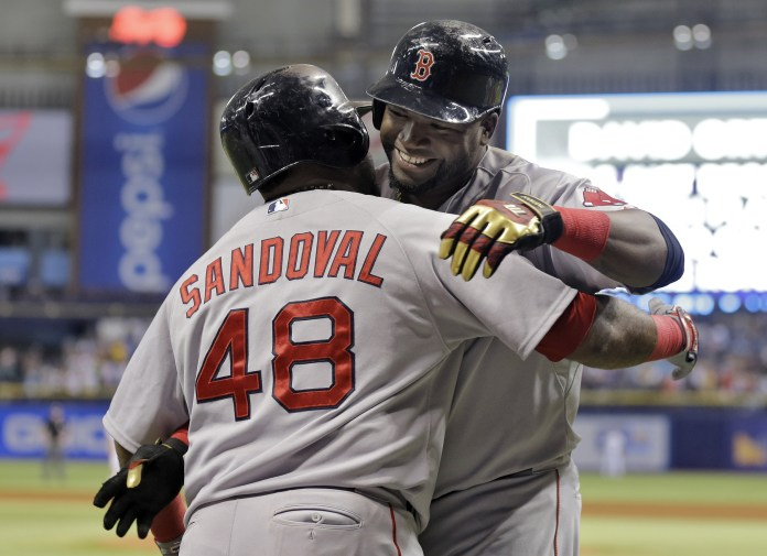 Boston Red Sox's David Ortiz, right, hugs Pablo Sandoval after Ortiz hit his 500th career home run off Tampa Bay Rays starting pitcher Matt Moore during the fifth inning of a baseball game Saturday, Sept. 12, 2015, in St. Petersburg, Florida.(Chris O'Meara/AP)
