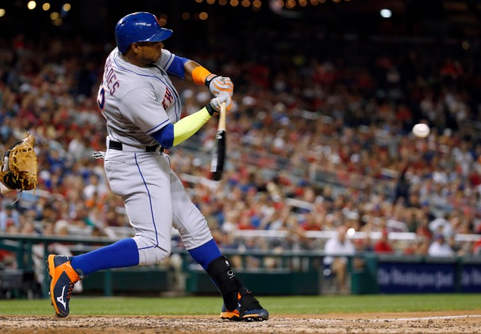 New York Mets' Yoenis Cespedes hits a two-run home run during the eighth inning of a baseball game against the Washington Nationals at Nationals Park, Wednesday, Sept. 9, 2015, in Washington. The Mets won 5-3. (Alex Brandon/AP)