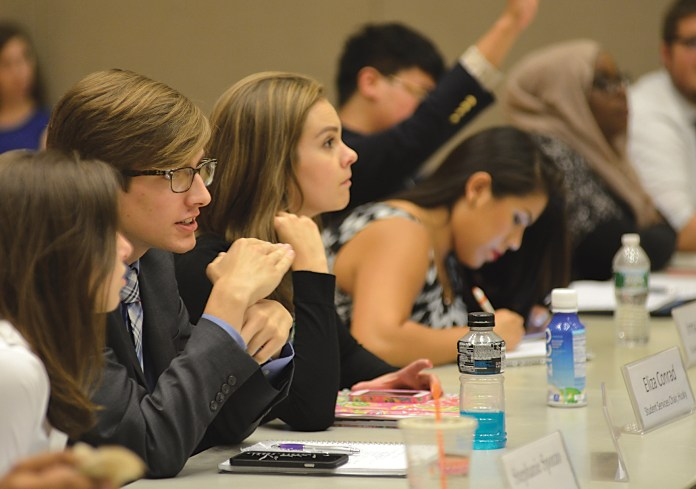USG senators speak during the Undergraduate Student Government's meeting in the Student Union on Wednesday, Sept. 16, 2015. (Jason Jiang/The Daily Campus)