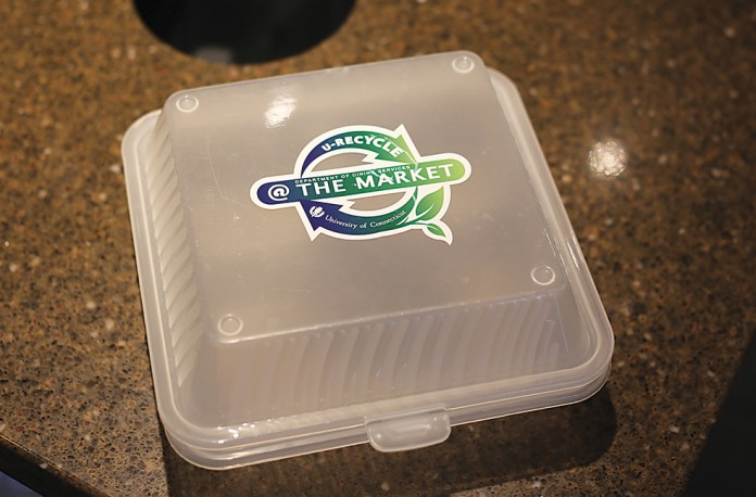 In this photo, a UConn Student Union reusable takeout container is pictured.The containers, made with 100-percent BPA free polypropylene, can then be left in a drop box in the food court to be sanitized for future use. (Jackson Haigis/The Daily Campus)