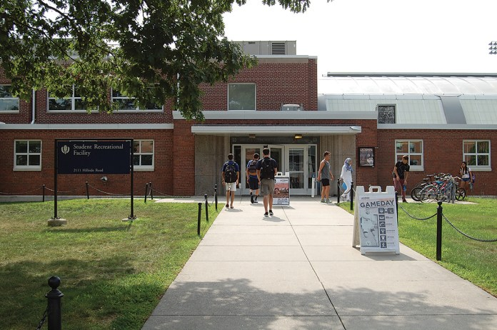 In this photo, UConn students walk near the entrance to the Rec Center on Sept. 1, 2015. The university plans to build a $100 million recreation facility by 2019 on the current site of the Connecticut Commons residential area.(Ashley Maher/The Daily Campus)