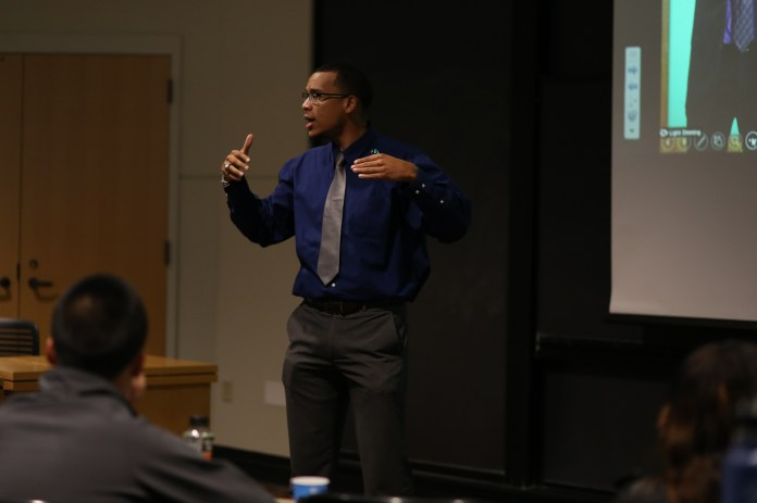 Motivational speaker Michael Mallery speaks during his presentation about building a personal brand to students at UConn's School of Business on Monday, Oct. 5, 2015. (Jackson Haigis/The Daily Campus)