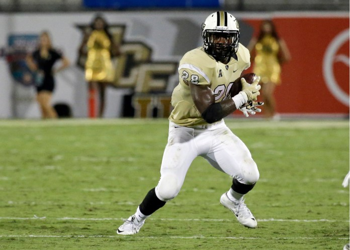 In this Sept. 3, 2015, file photo, Central Florida's William Stanback carries the ball against Florida International during the second half of an NCAA college football game in Orlando, Florida. (John Raoux, File/AP)