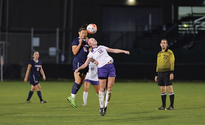 In this file photo, UConn freshman forward Shannon Walsh goes up for a header during the Huskies' game against East Carolina at Joseph J. Morrone Stadium on Thursday, Oct. 8, 2015. (Jason Jiang/The Daily Campus)