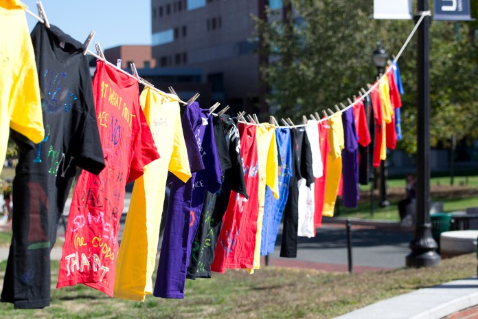 Shirts are seen hanging on a clothesline outside of the UConn Student Union on Fairfield Way on Monday, Oct. 12, 2015. The shirts commemorate victims and honor the survivors of sexual assault. (Rebecca Newman/The Daily Campus)