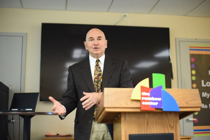 """John-Manuel Andriote, author and leading HIV/AIDS reporter, speaks during his lecture """"How Building Resilient Gay Men Saves Lives and Why It's Good for America,""""part of the Rainbow Center's Out to Lunch series, on Wednesday, Oct. 14, 2015. (Allen Lang/The Daily Campus)"""