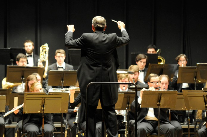 Jeffrey Renshaw conducts the UConn Wind Ensemble during its fall concert at the J. Louis von der Mehden Recital Hall in Storrs, Connecticut on Thursday, Oct. 15, 2015. (Amar Batra/The Daily Campus)