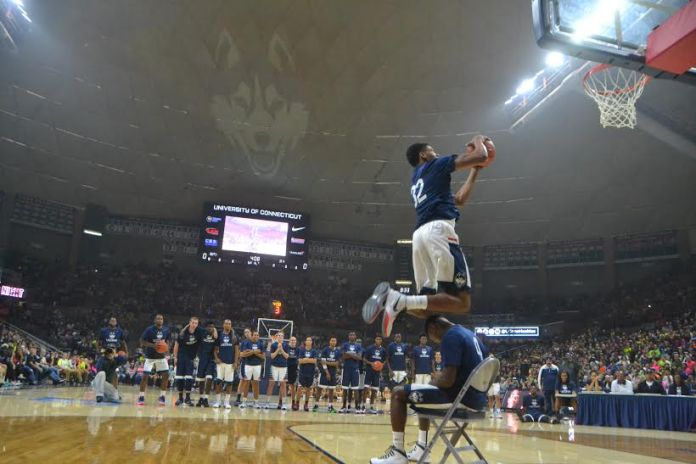 Shonn Miller dunks over Sterling Gibbs as part of first night's dunk contest (Bailey Wright/The Daily Campus)