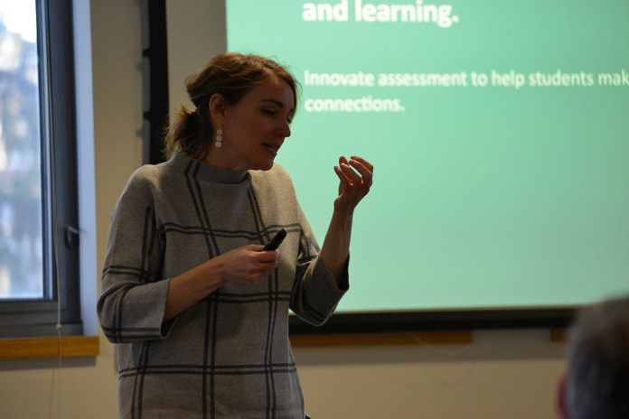 Professor Mya Poe of Northeaster University presents her research on assessing students' writing in the Philip E. Austin building on Monday, Oct. 19, 2015. (Jason Jiang/The Daily Campus)