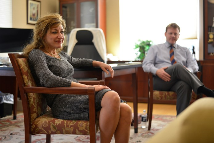 UConn president Susan Herbst sits in her office during her office hours on Wednesday, Oct. 21, 2015. (Jason Jiang/The Daily Campus)