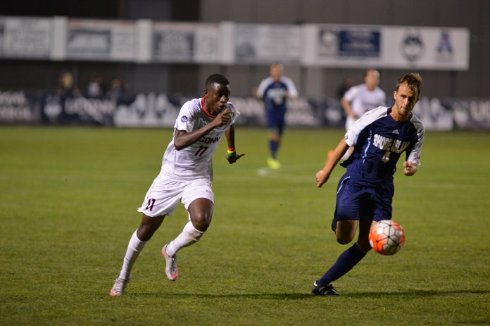 UConn freshman forward Abdou Mbacke Thiam fights for the ball during the Huskies' game against the Rams at Joseph J. Morrone Stadium in Storrs, Connecticut on Saturday, Sept. 19, 2015. Thiam's game-tying goal with one-second left in regulation helped the Huskies secure a draw Saturday against Tulsa. (Jason Jiang/The Daily Campus)