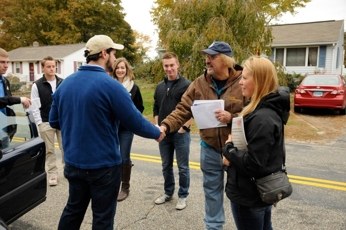 Mark Sargent shakes hands with Republican board of education candidate Al Fratoni after the two campaigned together Saturday morning. Members of the UConn College Republicans split into two groups to canvas several neighborhoods with each candidate. (Amar Batra/The Daily Campus)