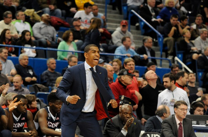 UConn men's basketball head coach Kevin Ollie is seen on the sidelines during the Huskies' game against Cincinnati during the 2015 American Athletic Conference championship at XL Center in Hartford, Connecticut on March 13, 2015. (File Photo/The Daily Campus)