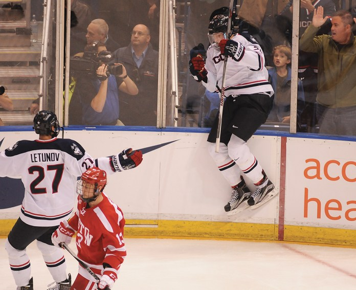 UConn men's hockey freshman forward Tage Thompson (right) celebrates after scoring a goal during the Huskies' game against Boston University at XL Center in Hartford, Connecticut on Tusday, Oct. 27, 2015. (Amar Batra/The Daily Campus)