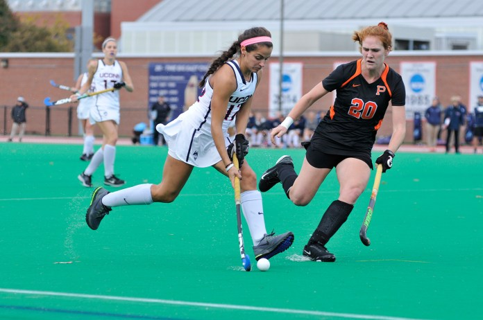 Junior Olivia Bolles moves the ball during UConn's victory over Princeton at the Sherman Family Sports Complex in Storrs, Connecticut on Oct.25, 2015. UConn will attempt to finish their perfect season this weekend against Georgetown. (Jason Jiang/The Daily Campus)