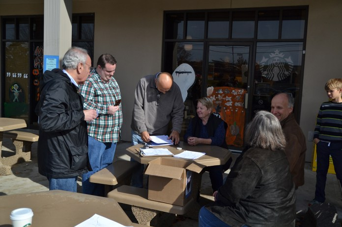 Town council member Paul Shapiro (left) and other members of Mansfield Democrats plan a campaign route in the Storrs Commons shopping area in Mansfield, Connecticut on Saturday, Oct. 31, 2015. Democrats campaigned door-to-door to raise awareness about their campaign. Election Day is Nov. 3. (Amar Batra/The Daily Campus)