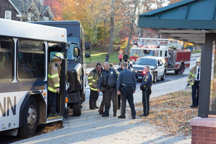 UConn police officers and fire department personnel inspect the scene of the collision between a UConn Transportation bus and a UPS deliver truck at the Arjona Westbound stop on Tuesday, Nov. 3, 2015. (Fritz Bacon/The Daily Campus)