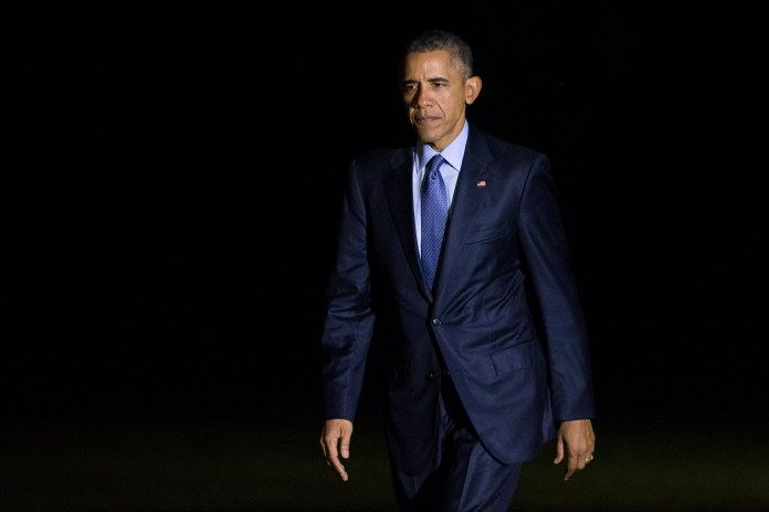President Barack Obama walks to the White House after arriving on the South Lawn, on Tuesday, Nov. 3, 2015, in Washington. Obama spent the day attending events in New York and New Jersey. (Evan Vucci/AP)