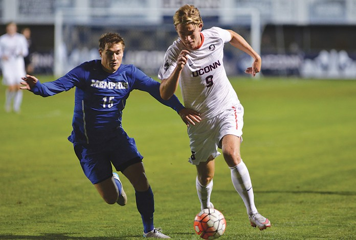 UConn men's soccer forward Fredrik Jonsson fights off a Memphis defender during the Huskies' game against the TIgers at Joseph J. Morrone Stadium in Storrs, Connecticut on Saturday, Oct. 3, 2015.(Amar Batra/The Daily Campus)