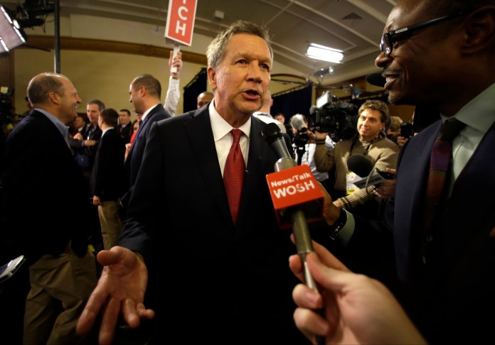 John Kasich talks to reporters in the spin room after the Republican presidential debate at the Milwaukee Theatre, Tuesday, Nov. 10, 2015, in Milwaukee. (Jeffrey Phelps/AP)