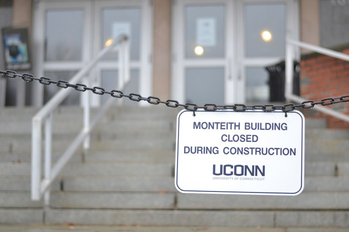 In this photo, a sign is pictured in front of the Henry Ruthven Monteith Building in Storrs, Connecticut on Thursday, Nov. 12, 2015. The building renovation is in full swing, with an expected completion date of August 2016.(Rebecca Newman/The Daily Campus)