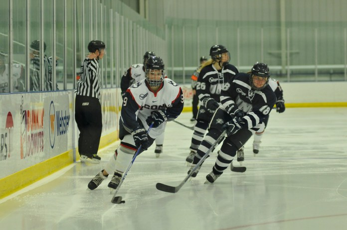 UConn junior defender Jessica Stott handles the puck during the Huskies' game against New Hampshire at the Freitas Ice Forum in Storrs, Connecticut on Sunday, Nov. 8, 2015.