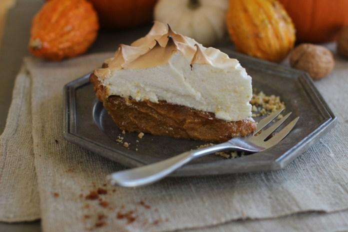 This Oct. 12, 2015 photo shows citrus pumpkin meringue pie in Concord, NH. This  Thanksgiving pie is deliciously deceptive, hidden under the meringue is a classic pumpkin pie spiked with just a hint of citrus. (AP).