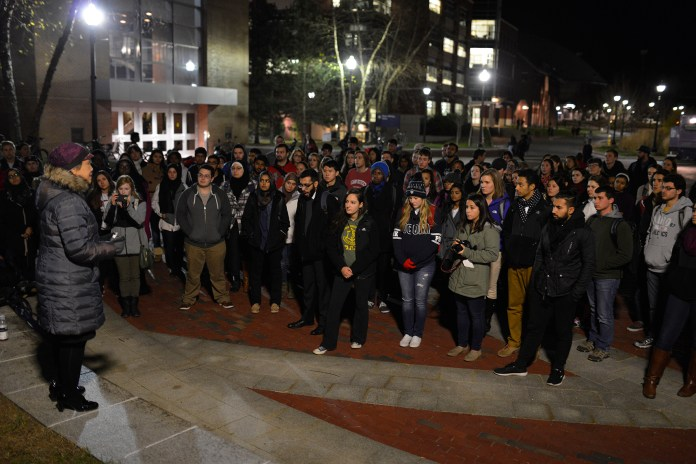 A speaker addresses the crowd at the vigil, organized by AsACC. (Jason Jiang/Daily Campus)