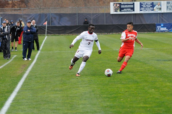 UConn men's soccer junior midfielder Kwame Awuah dribbes the ball during the Huskies' NCAA tournament game against Boston University at Morrone Stadium in Storrs, Connecticut on Thursday, Nov. 19, 2015.Awuah recorded two goals and an assist to lead UConn past the Terriers 3-1. (Amar Batra/The Daily Campus)