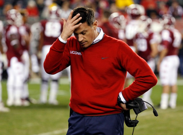 Connecticut head coach Bob Diaco reacts during a review of a possible Temple touchdown in the second half of an NCAA college football game, Saturday, Nov. 28, 2015, in Philadelphia. (AP Photo/Chris Szagola)