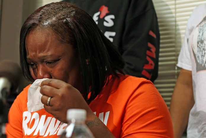 Dorothy Holmes, the mother of 25-year-old Ronald Johnson, speaks at a news conference Tuesday, Dec. 1, 2015, in Chicago, asking that the dash-cam video of her son Ronald being fatally shot by Chicago police on Oct. 12, 2014, be released. (Chicago Tribune via AP )