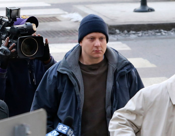 Chicago police officer Jason Van Dyke, accused of fatally shooting a black teenager, arrives at the Leighton Criminal Courthouse in Chicago on Tuesday, Nov. 24, 2015. Van Dyke was charged with first degree murder in the killing of 17-year-old Laquan McDonald. (Chicago Tribune via AP)