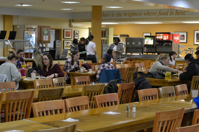 Students eat at Whitney dining hall, home to locally grown, vegetarian and vegan-friendly food options. (Rebecca Newman/The Daily Campus)