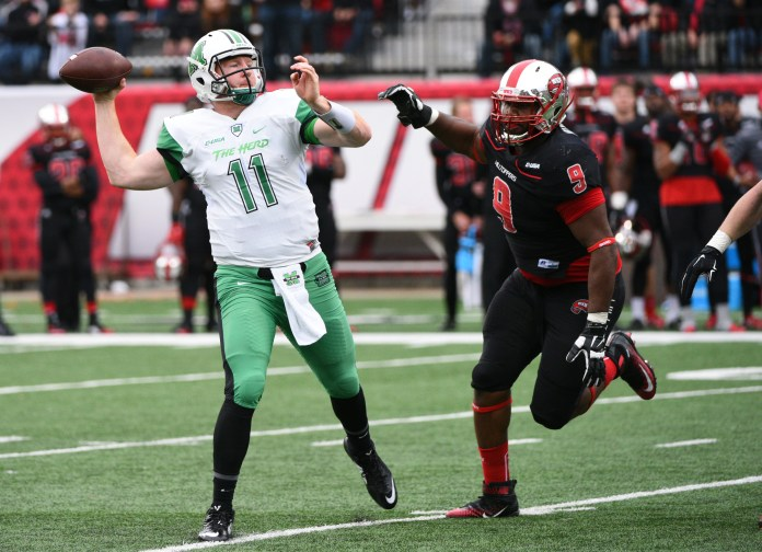 Marshall quarterback Michael Birdsong (11) is pressured by Western Kentucky defensive lineman Omarius Bryant (9) in the second half of a NCAA college football game on Friday, Nov. 27, 2015, at L.T. Smith Stadium in Bowling Green, Ky. (Michael Noble Jr./AP)