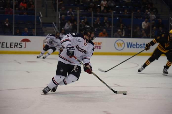 UConn defenseman Johnny Austin handles the puck at the XL Center in Hartford, Connecticut on Oct. 16, 2015 against Arizona State (Zhelun Lang/The Daily Campus)