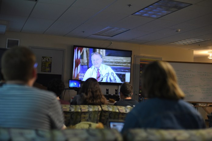 """Students look on during a showing of """"How to Survive a Plague"""" at UConn's Rainbow Center in the Student Union on Monday, Jan. 18, 2016. (Allen Lang/The Daily Campus)"""