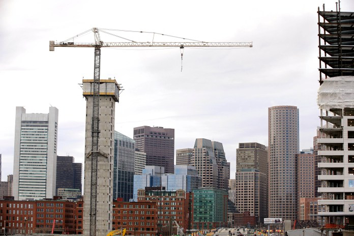 General Electric said Wednesday, Jan. 13, 2016, it will begin relocating its global headquarters to Boston's Seaport District, pictured above,in the summer from Fairfield, Conn., and complete the move by 2018. In recent years, the Seaport District has become the city's hottest and fastest-growing neighborhood. (AP)