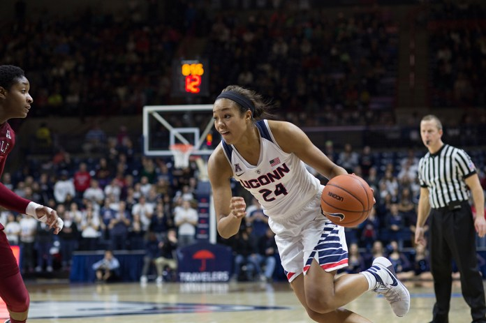 Napheesa Collier attacks the basket during UConn's victory against Temple. Collier loves Beyonce, Instagram, and Kevin Durant.(Jackson Haigis/The Daily Campus)