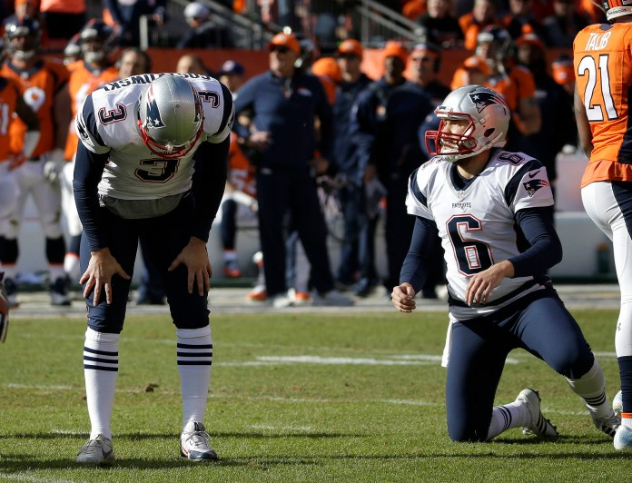 New England Patriots punter Ryan Allen (6) looks on as Patriots kicker Stephen Gostkowski reacts after missing an extra point following a touchdown by Steven Jackson during the first half the NFL football AFC Championship game between the Denver Broncos and the New England Patriots, Sunday, Jan. 24, 2016, in Denver. (Chris Carlson/AP)