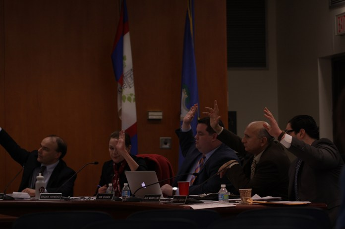 Members of the Mansfield Town Council unanimously vote to ban tobacco in Storrs Center at the council's meeting on Monday, Jan. 25, 2016. (Mei Buzell/The Daily Campus)