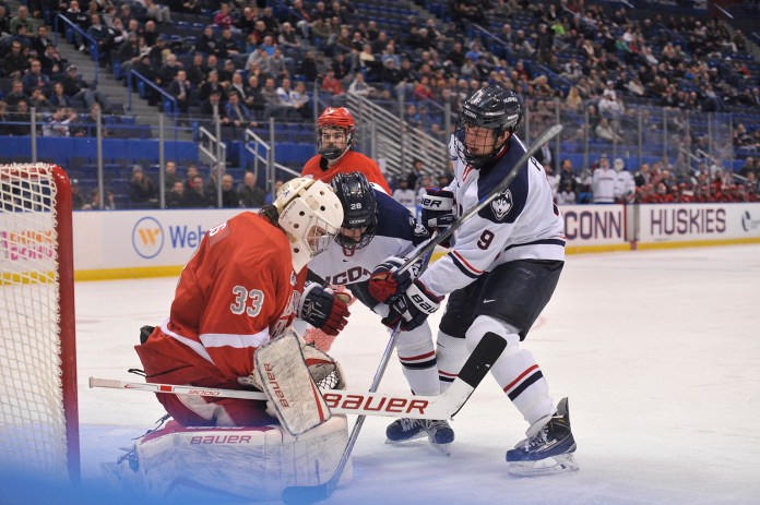 Shawn Pauly works to put the puck in the net during UConn's 7-4 loss to Sacred Heart at the XL Center on Tuesday January 26, 2016. (Jason Jiang/The Daily Campus)