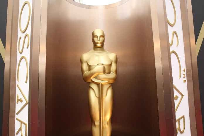 In this March 2, 2014 file photo, an Oscar statue is displayed at the Oscars at the Dolby Theatre in Los Angeles. Since the Academy of Motion Pictures Arts and Sciences said that it was altering membership rules in response to an outcry over the diversity of its voters and of its nominees, another uproar has erupted around Hollywood.(Matt Sayles/Invision/AP, File)