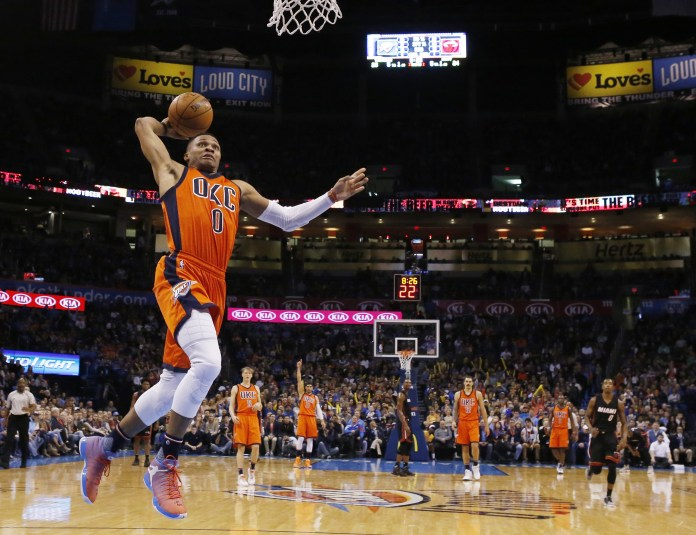 Oklahoma City Thunder guard Russell  Westbrook (0) goes up for a dunk in the second quarter of an NBA basketball game against the Miami Heat in Oklahoma City, Sunday, Jan. 17, 2016. (AP Photo/Sue Ogrocki)