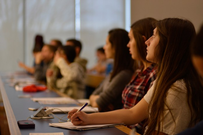 Students look on during a presentation by Hillary Sunderland,an associate in Cigna's marketing leadership development program, in Laurel Hall on Monday, Feb. 1, 2016. (Jason Jiang/The Daily Campus)