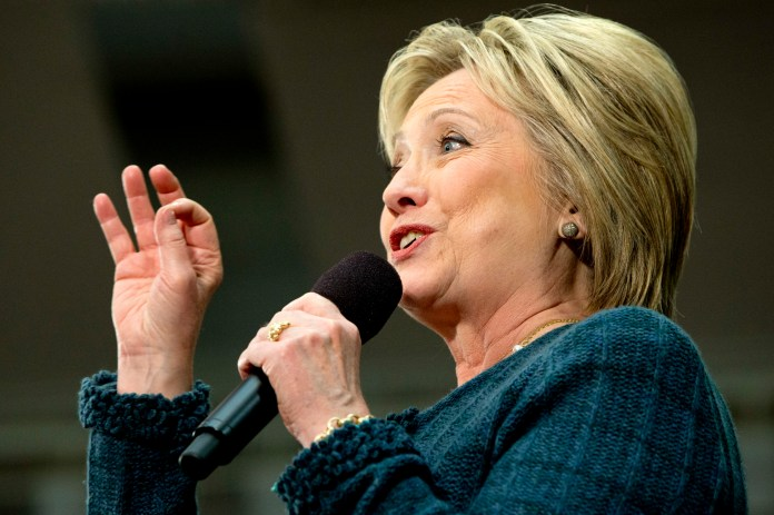 """Democratic presidential candidate Hillary Clinton speaks at a """"Get Out the Vote"""" event at Rundlett Middle School, in Concord, N.H., Saturday Feb. 6, 2016. (AP Photo/Jacquelyn Martin)"""