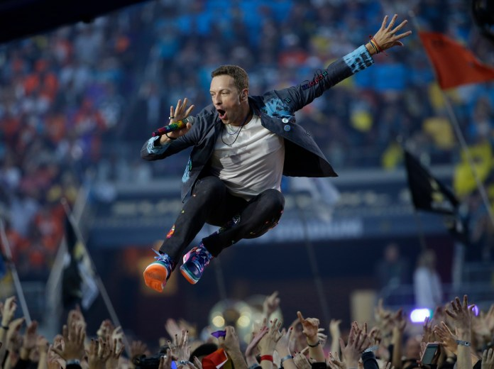 Coldplay singer Chris Martin performs during halftime of the NFL Super Bowl 50 football game Sunday, Feb. 7, 2016, in Santa Clara, Calif. (AP Photo/Marcio Jose Sanchez)