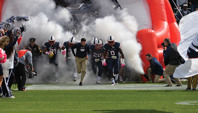 Bob Diaco leads UConn out of the tunnel at Pratt & Whitney Stadium at Rentschler Field on Oct. 17, 2015 Football vs. USF (Ashley Maher/The Daily Campus)