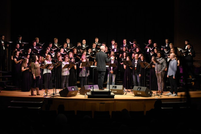Roomful of Teeth, a vocal ensemble founded in 2009 by Brad Wells, perform with UConn Choir, UConn Wind Ensembles and UConn Orchestra and Von Der Mehden Recital Hall on Wednesday night. (Zhelun Lang/The Daily Campus)