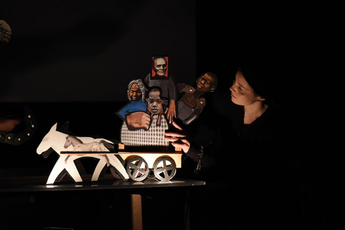 """A student puppeteer is seen during Puppetsweat Theater's performance of """"The Autobiography of James Mars: A Slave Born and Sold in Connecticut"""" at the Ballard Institute and Museum of Puppetry on Saturday, Feb. 13, 2016. (Allen Lang/The Daily Campus)"""