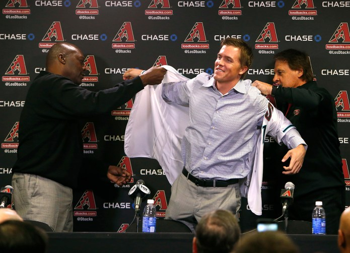 FILE - In this Dec. 11, 2015, file photo, Arizona Diamondbacks General Manager Dave Stewart, left, and Chief Baseball Officer Tony La Russa, right, introduce pitcher  Zack  Greinke to the media during a press conference, in Phoenix. (AP Photo/Rick Scuteri, File)